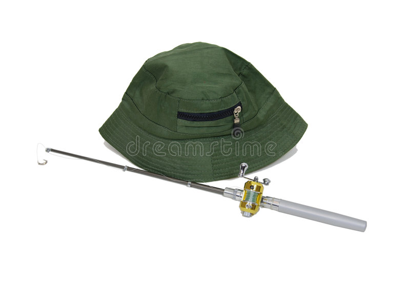 Fishing Pole and hat. Fishing pole with rod and reel used to catch fish and a hat to avoid sunburn-Path included royalty free stock photography
