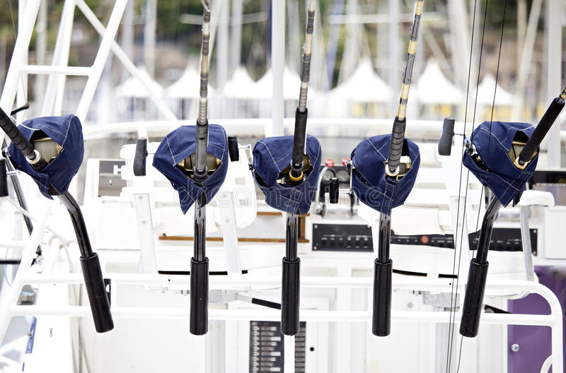 Fishing Pole Rods. Five Fishing Pole Rods and Reels royalty free stock image