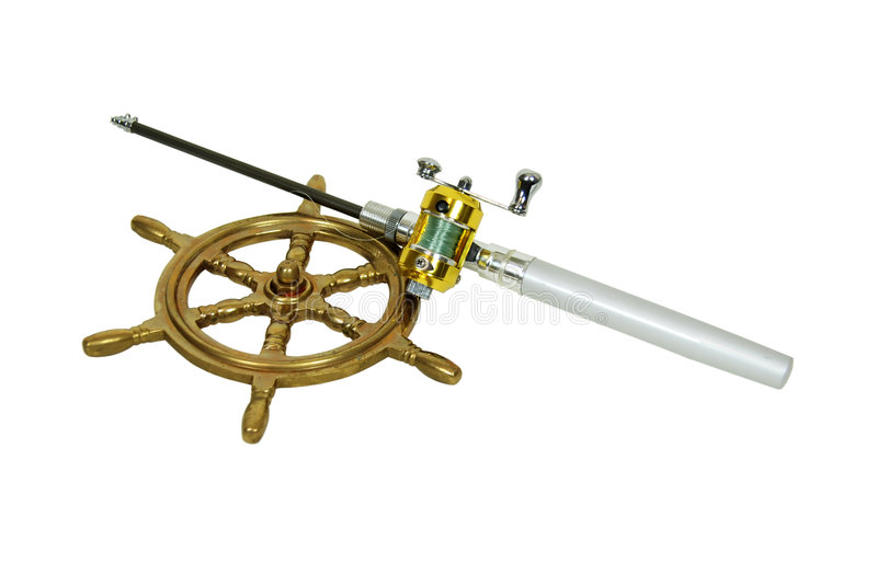Fishing Pole and wheel. Fishing pole with rod and reel used to catch fish, nautical steering wheel made of brass stock photo