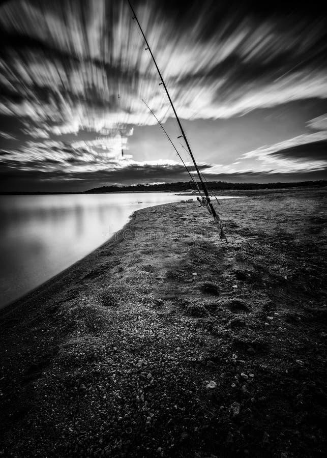 Free Fishing Poles On The Lake Royalty Free Stock Image - 28702456