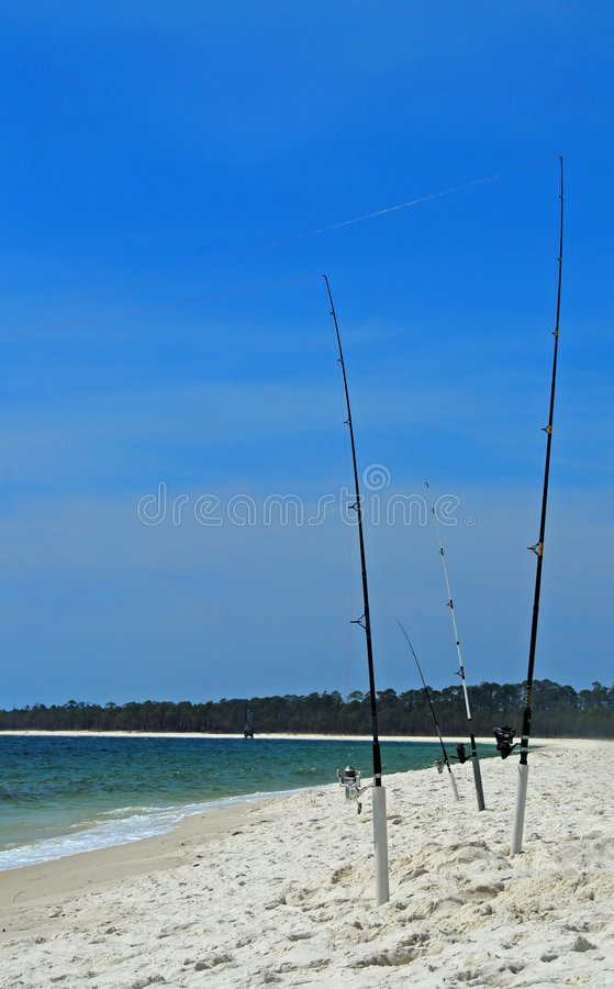 Fishing Poles in Sand stock photography