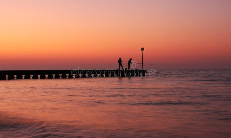 Fishing on a pontoon royalty free stock images