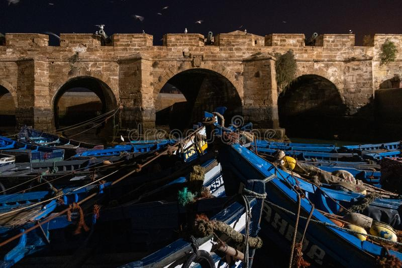 Fishing port of Essaouira at the night time, Morocco. Blue ships in the night port. Of Essaouira royalty free stock images