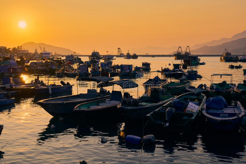 A fishing port in the sunset stock photo