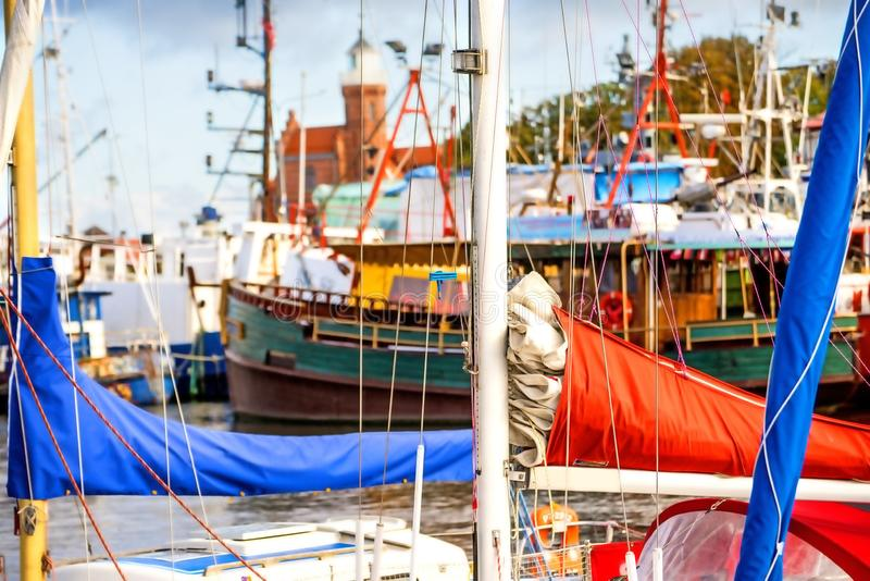 Fishing port of Ustka, Poland with old lighthouse. And boats royalty free stock photography
