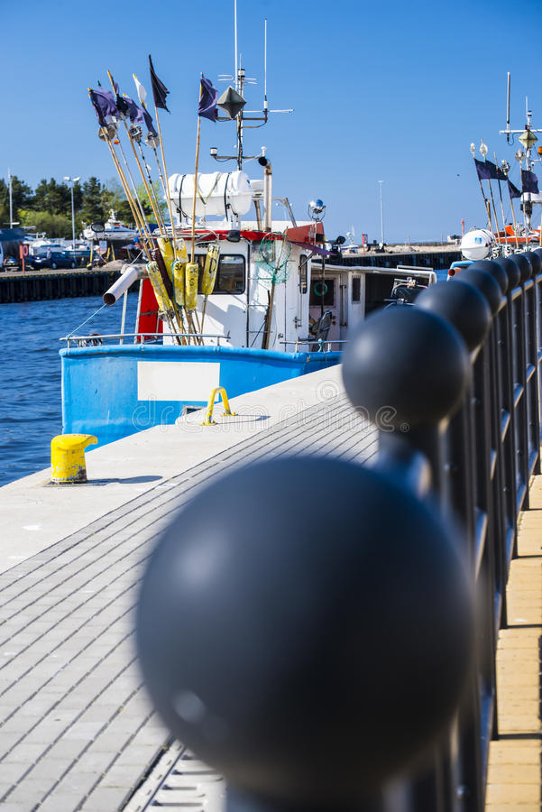 Fishing port of Ustka, Poland. With trawlers and buoys stock photos