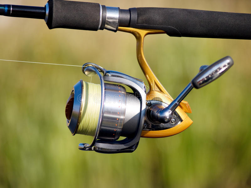 Fishing reel. The fisherman with a fishing reel stock image