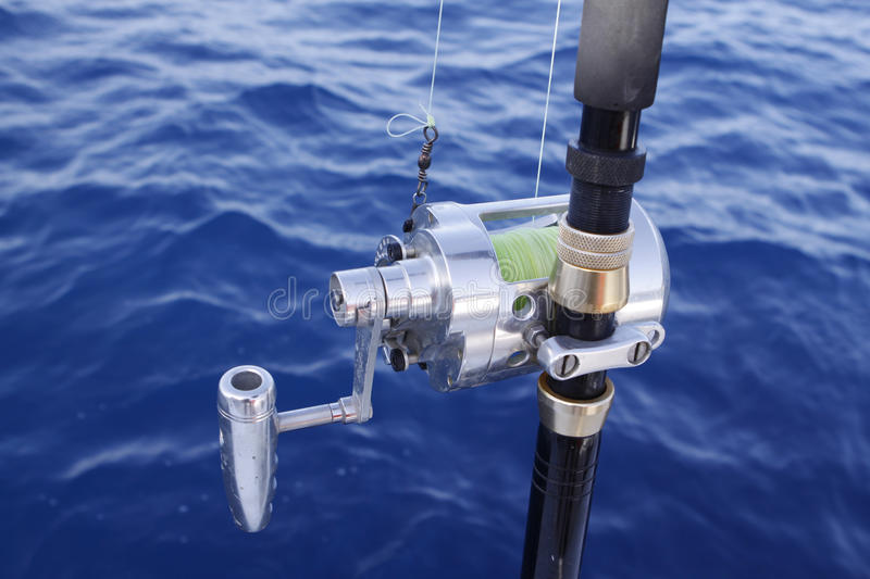 Fishing reel. Photo of a fishing reel during a fishing excursion at the canary islands.Spain royalty free stock photo