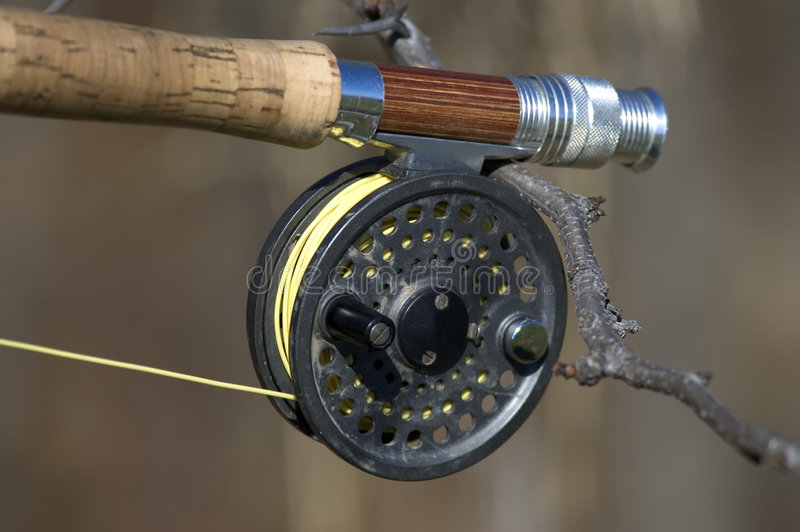 Fishing Reel. Closeup of a dusty fly fishing reel stock image