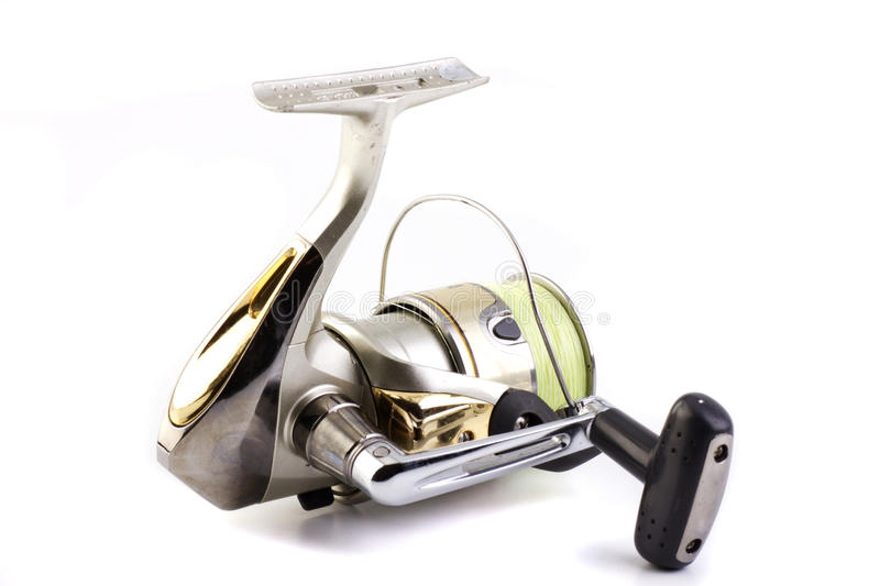 Fishing reel. Silver and Gold fishing reel isolated on white back ground royalty free stock photography