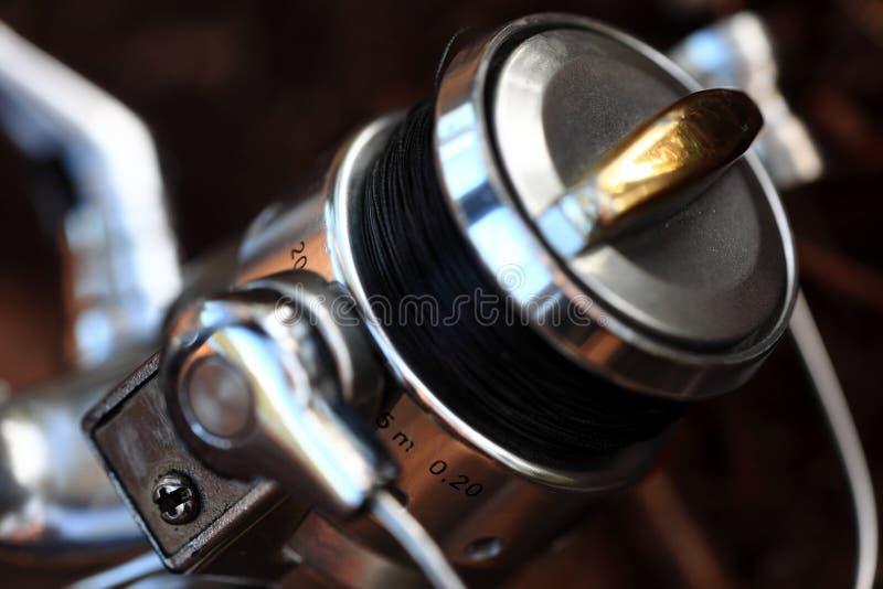 Fishing reel. Close up up a fishing reel stock image