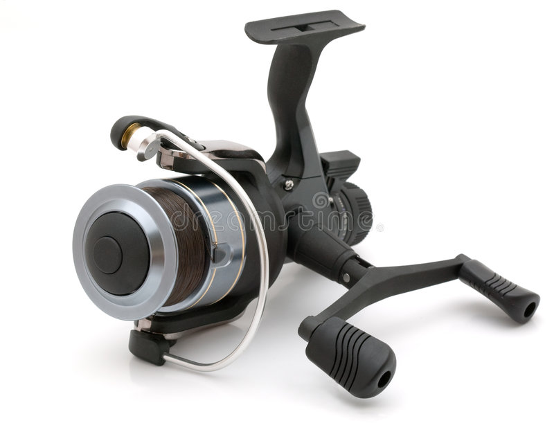 Fishing reel. Black graphite fishing reel, nobranded, isolated on a white background royalty free stock photos