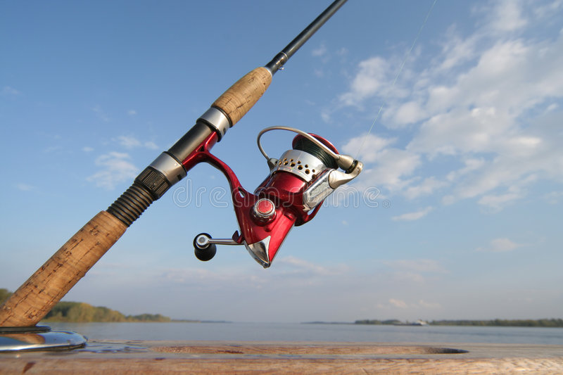 Fishing reel. A fishing reel on sky background stock image