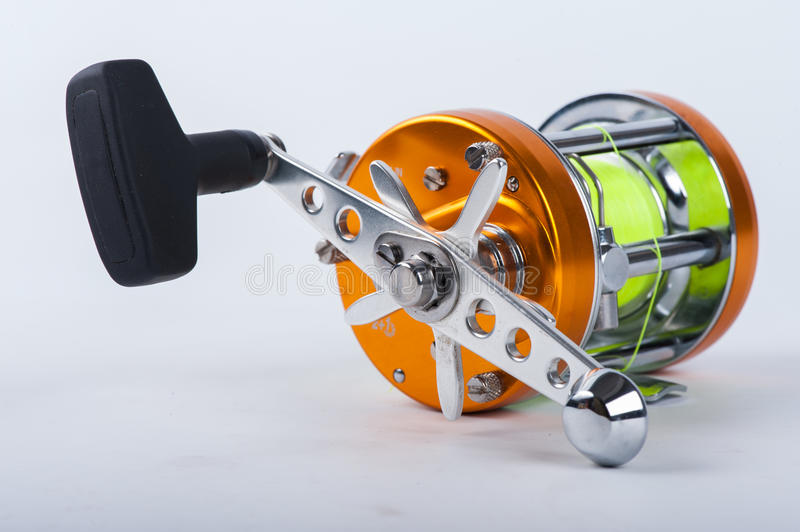 The fishing reel. For fishing over white royalty free stock image