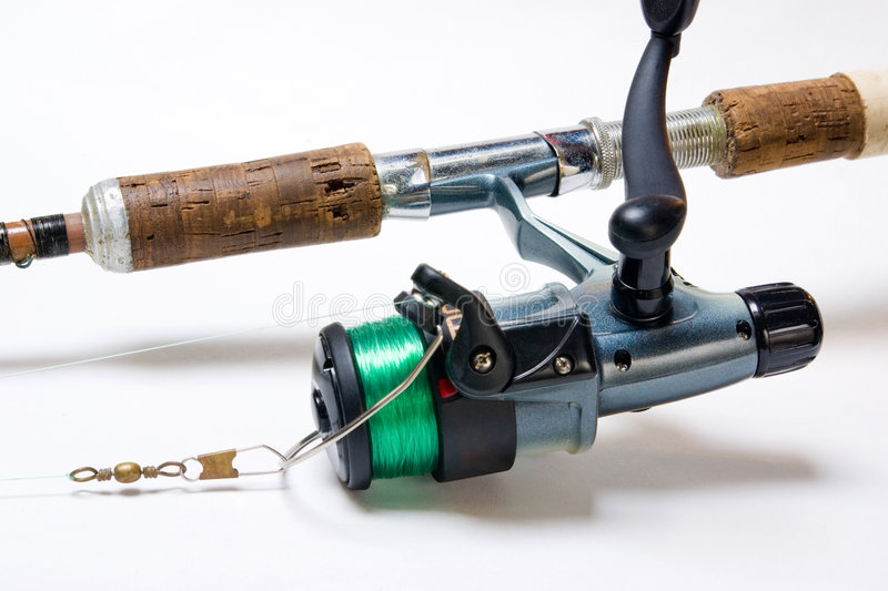 Fishing Reel. Detail of fishing rod and reel over white background royalty free stock photos