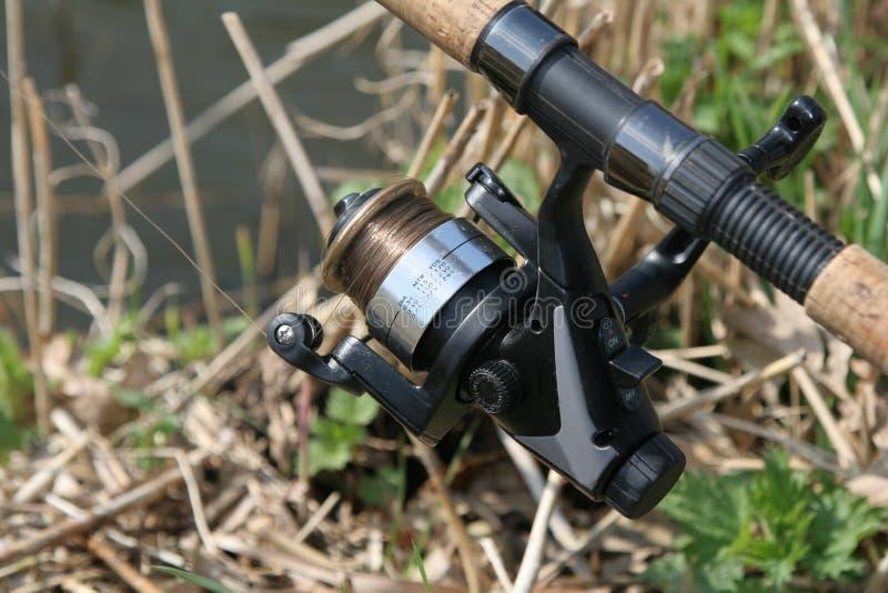 Fishing reel. Closeup of fishing reel outdoors stock photography