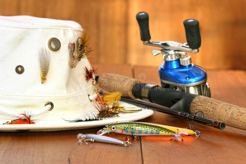 Download Fishing Reel With Hat And Color Lures Stock Photo - Image: 14537828
