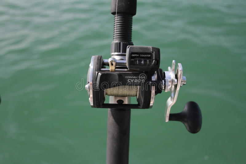 Fishing reel. A level wind fishing reel used on the great lakes and oceans royalty free stock photo