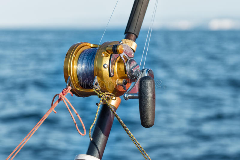 Fishing reel and pole royalty free stock images