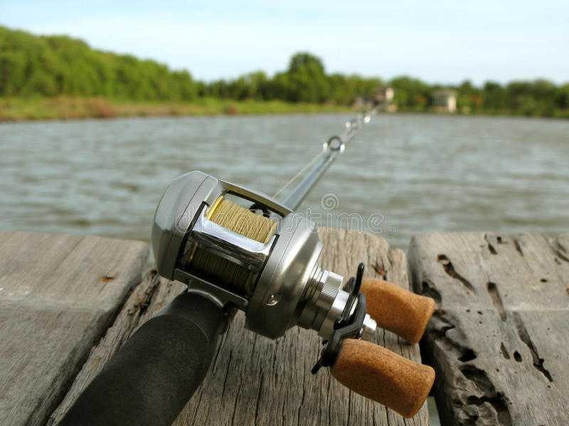 Fishing Reel with water. Fishing tackle, Spinning Reel with beautiful aluminum texture royalty free stock photos