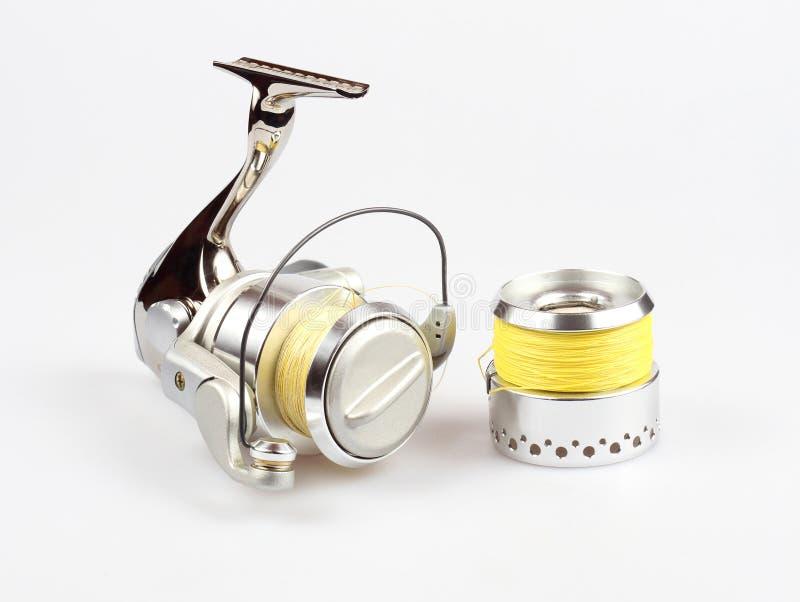 Fishing reel. On white background royalty free stock photos