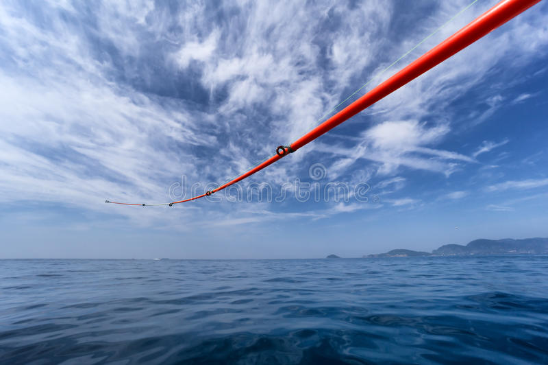 Fishing rod against sea and sky stock photo