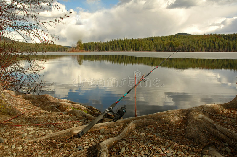 Download Fishing Rod Placed On The Ground Near A  Lake Stock Image - Image: 779321