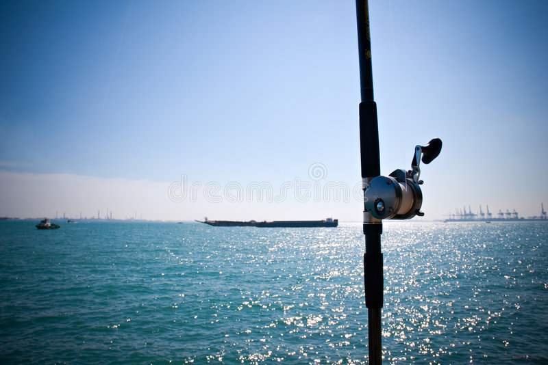 Download Fishing rod by the sea stock photo. Image of reflect, boat - 7521926