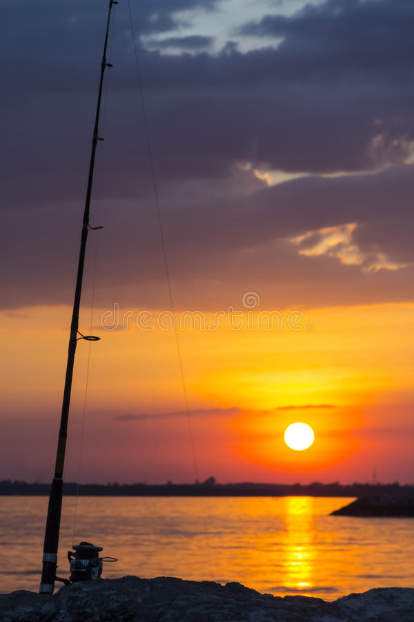 Fishing rod in twilight royalty free stock photography