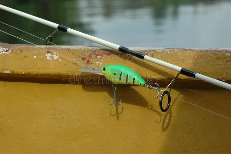 Fishing Rod, Yellow, Water, Boats And Boating Equipment And Supplies royalty free stock images