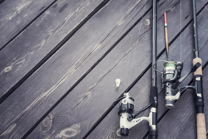 Fishing rods on the wooden deck stock photos