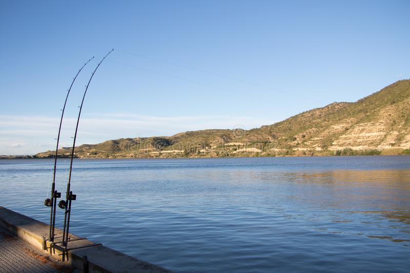 Fishing rods by the river Ebro royalty free stock photography