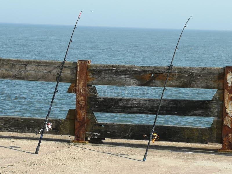 Fishing Rods at sea Norfolk stock photo