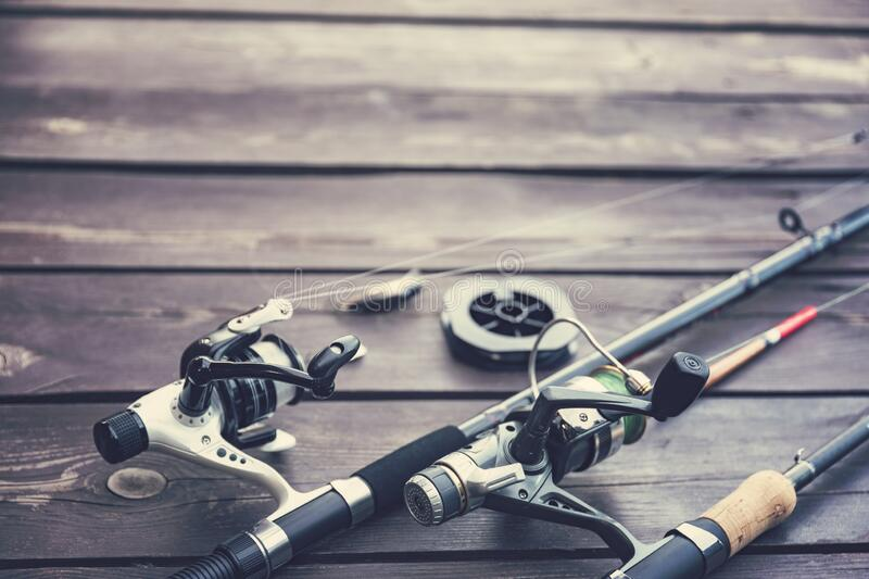 Fishing rods on the wooden deck royalty free stock image