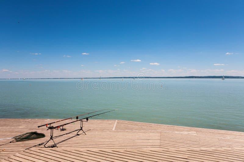 Fishing rods on wooden pier at Lake Balaton royalty free stock image
