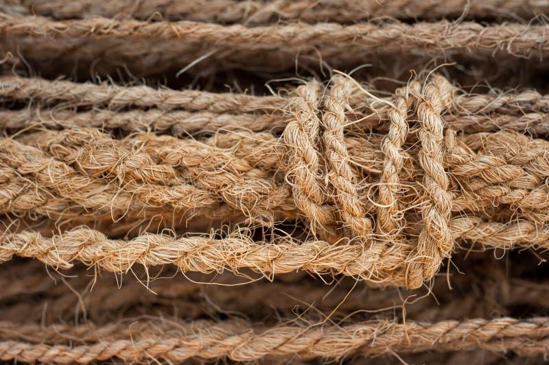 Fishing rope, manila close-up macro in port. Fishing rope, manila close-up macro in sea port royalty free stock photography