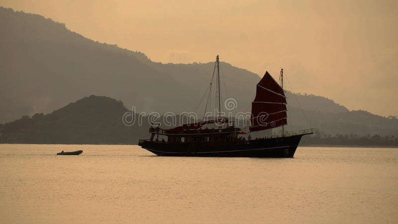 Fishing Schooner out to sea in the evening stock photos