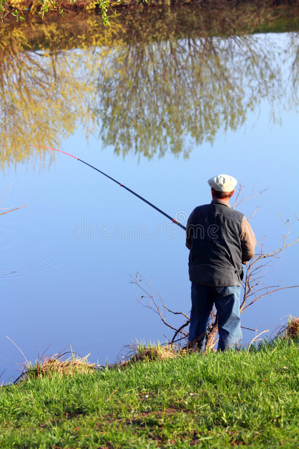 Download Fishing senior on lake stock photo. Image of pursuit - 23894200