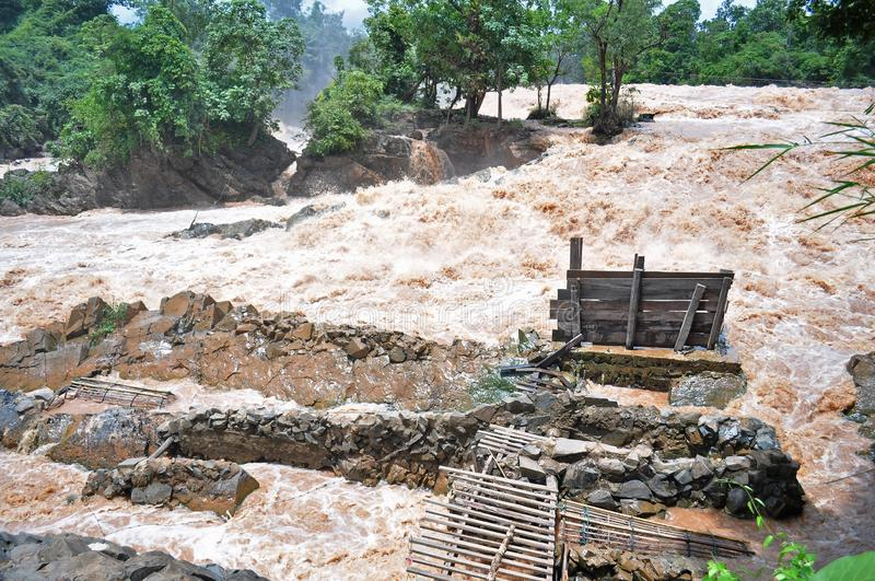 Fishing set at the Khone Phapheng falls on the Mekong River in Laos during the Monsoon flooding.  stock photos
