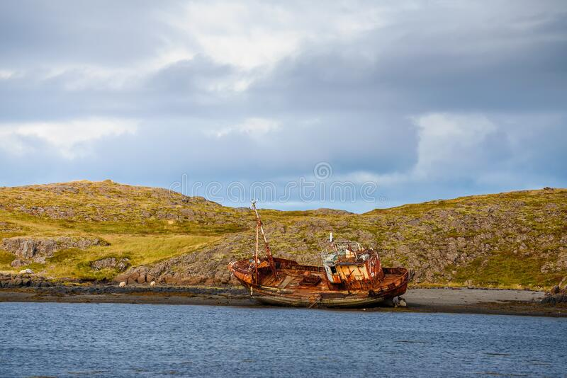 Fishing ship wreck laying on the Snaefellsnes peninsula in Iceland stock photo