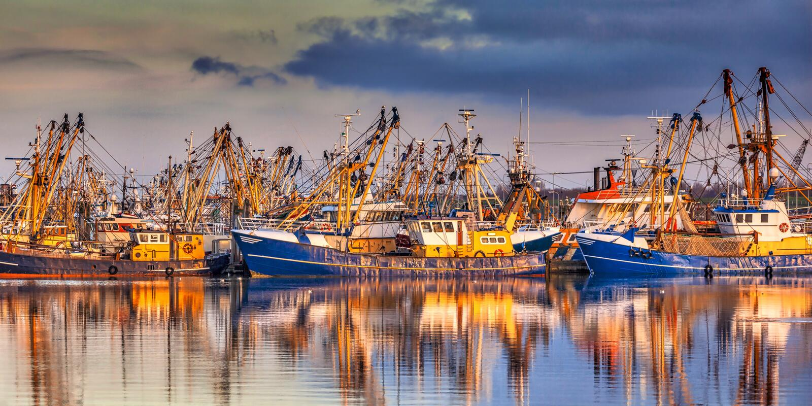 Fishing ships during majestic sunset stock image