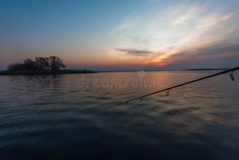 Fishing with spinning on river at morning. royalty free stock photos