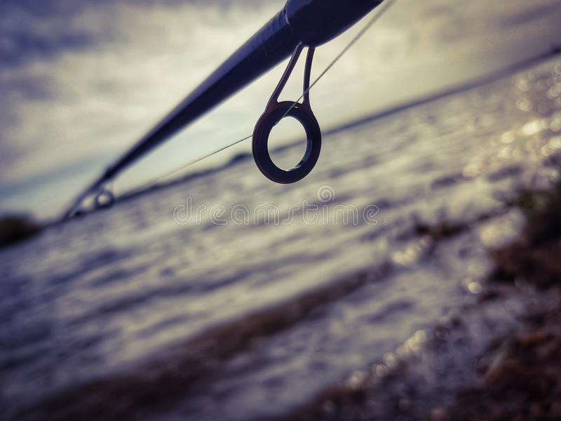 Fishing spinning on the river royalty free stock photos