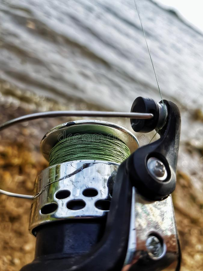 Fishing spinning on the river stock photography
