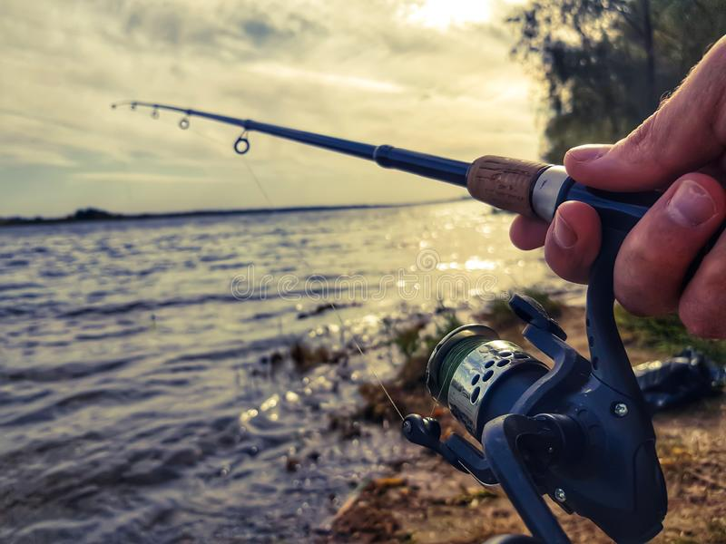 Fishing spinning on the river stock photo