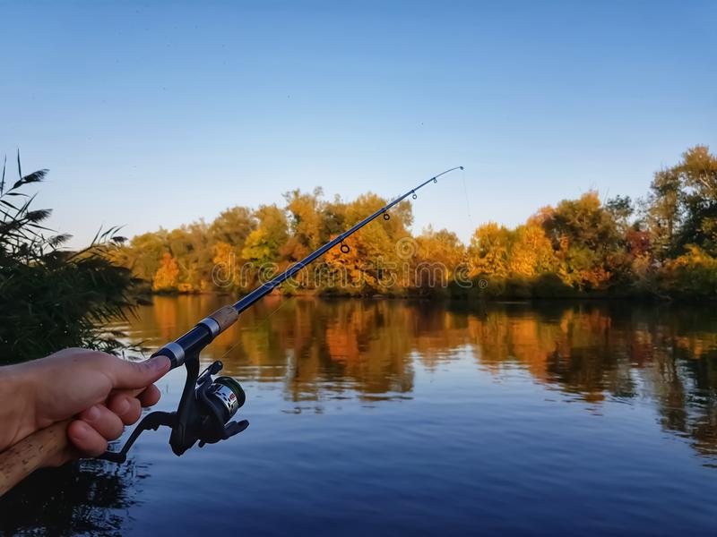 Fishing spinning on the river stock photos