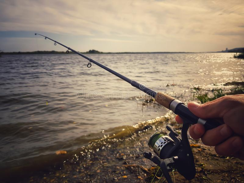 Fishing spinning on the river royalty free stock image