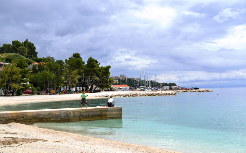 Fishing before the storm (Brela, Croatia) royalty free stock image