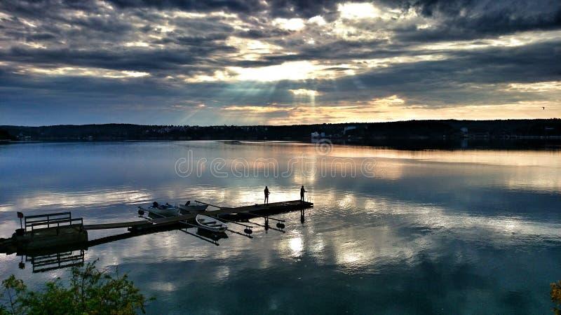 Fishing at sunrise royalty free stock image