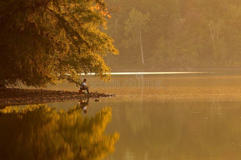 Fishing at Sunset stock photos
